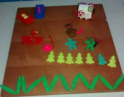 Maquete de biscuit composta por personagens das histórias lidas na Roda de Leitura.